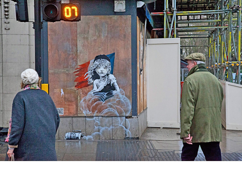 """Banksy's First Interactive Work Criticizes Police Violence Against Refugees"""
