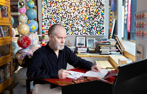 Douglas Coupland-- the focus of my attention at this week's conference in Toronto-- at his desk reading and writing. Image courtesy of  Ottawa Citizen