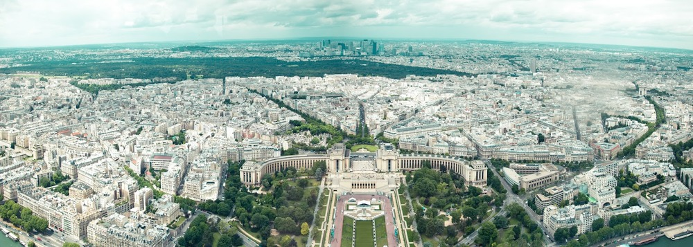 Taken during the Paris/Documenta 2012 Field School, photo courtesy of Kyubo Yun. A majestic view of Paris from atop the Eiffel Tower-- notice the Haussmannized streets and urban planning.