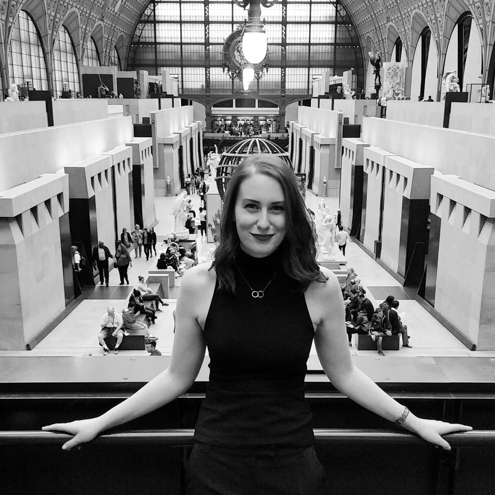 Ashley enjoying the spaces of the Orsay Museum-- a place dedicated to the transition from traditional French salon art to modern art.