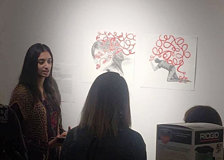 Gurleen discusses her response artwork at the final critique in the pre-departure studio class.