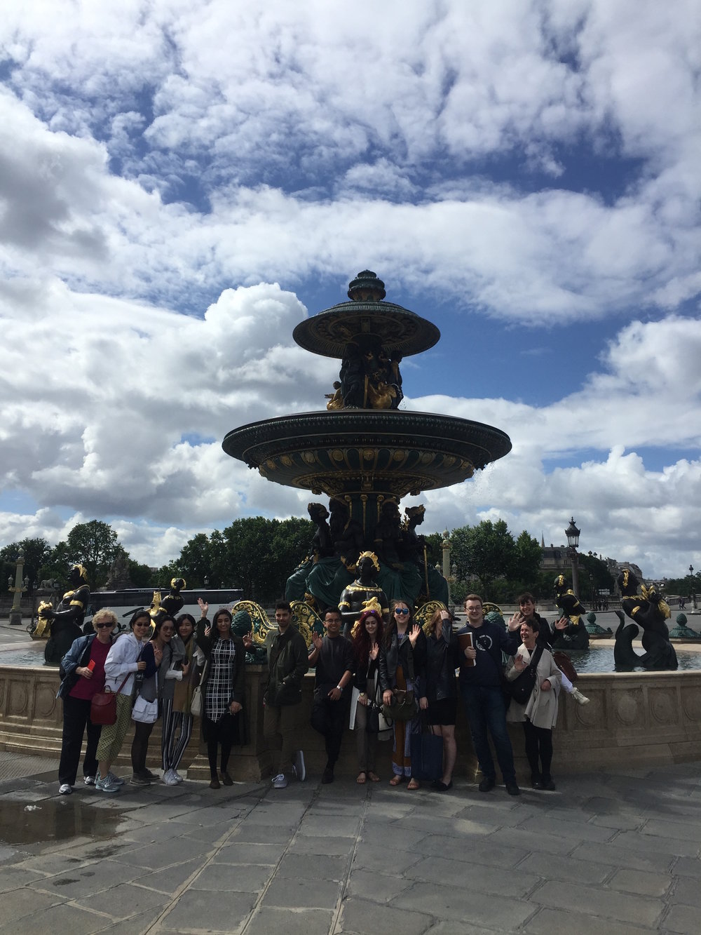 Enjoying the fountain at the the Place de Concorde-- Gurleen (in plaid dress) waving hello!
