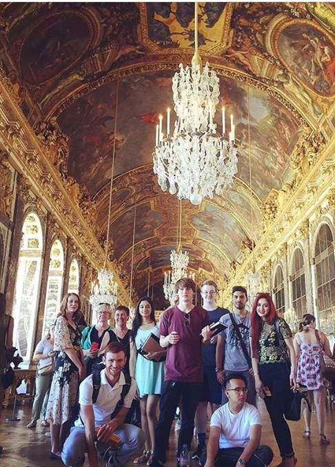 Group photo in the hall of mirrors at Versailles. Kaila wore a fetching vintage top with gold embellishments she purchased in Paris to match the occasion.