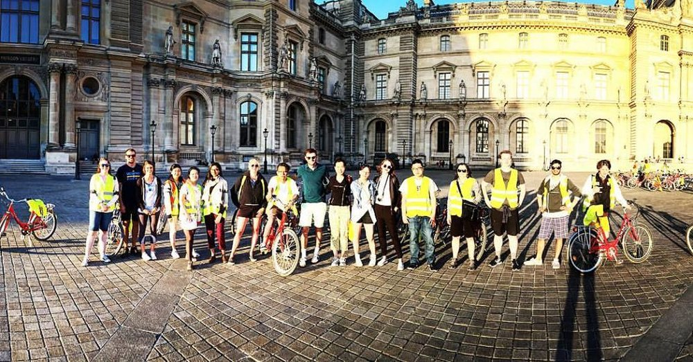 Group photo by the Louvre Palace on the sunset bike tour. Zoe is fifth from the left.