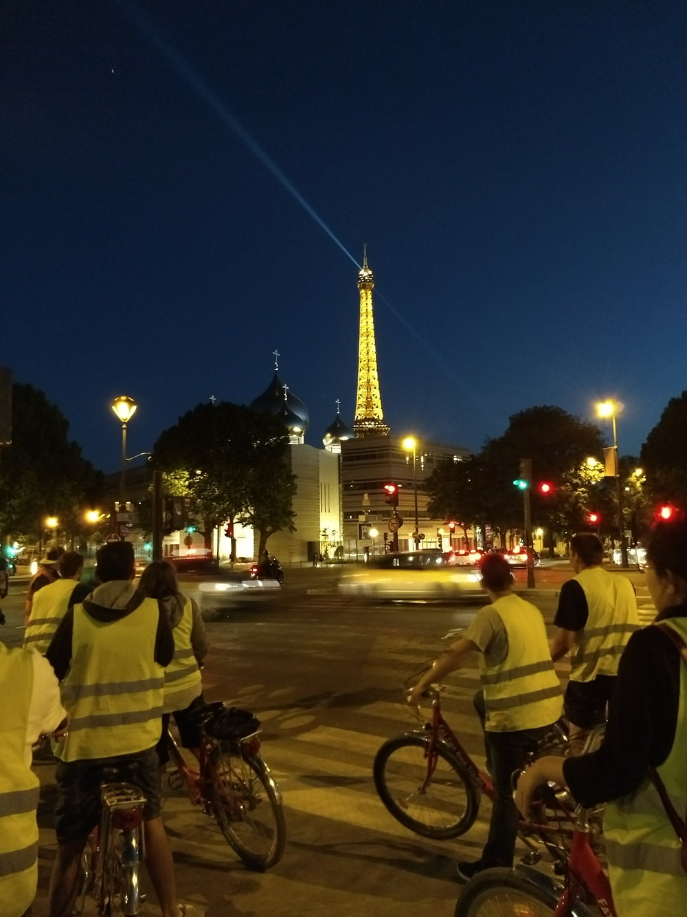 Enjoying the twinkly lights on the Eiffel Tower at the end of the bike tour.