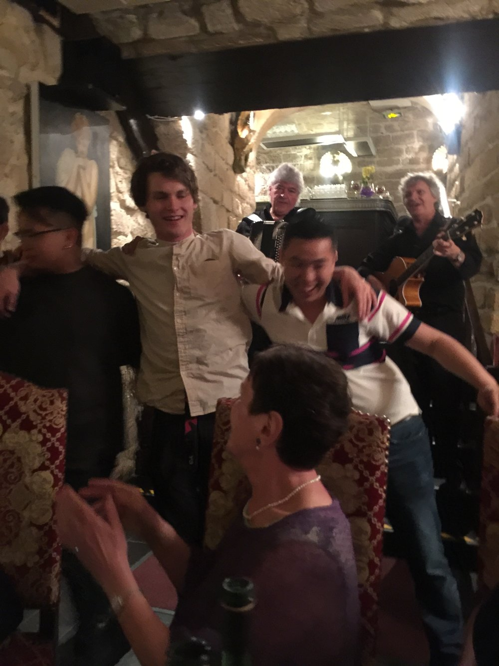 Nielsen having a great time dancing at the group dinner in the Latin Quarter of Paris.