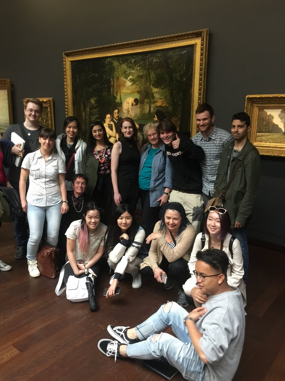 Group photograph at the Orsay in front of one of the most important works of modern art-- Edouard Manet's  Le Déjeuner sur l'herbe  (1863). Kate second from far left.