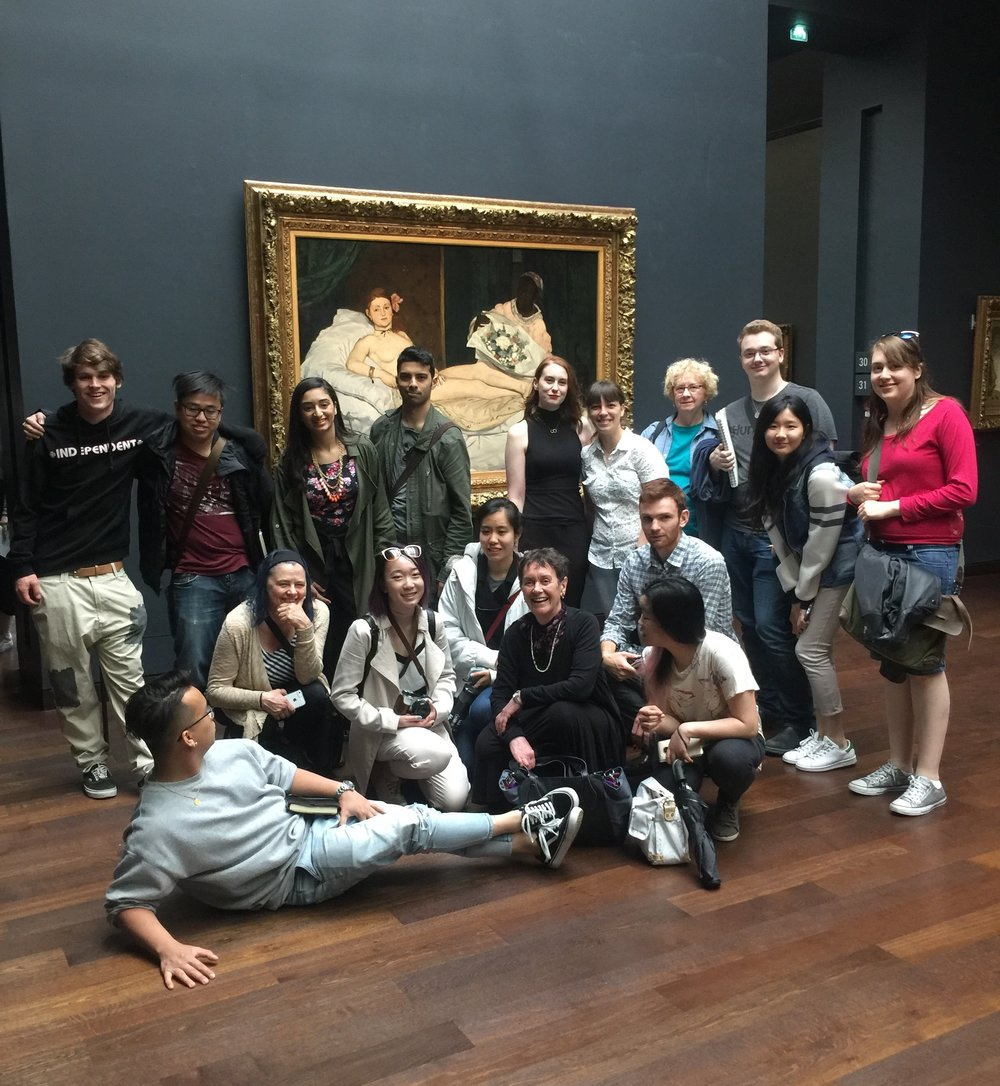 Elizabeth (first on left in second row) with the field school students, examining the iconic Olympia (1863) by Edouard Manet at the Orsay Museum.