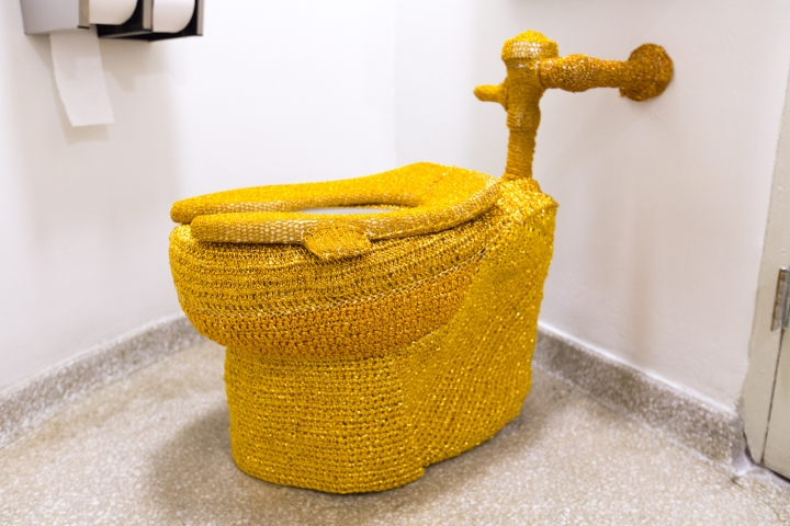 """Someone Yarn-Bombed a Guggenheim Museum Toilet with Gold Crochet"""