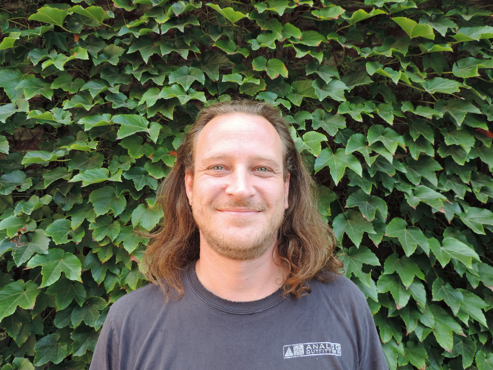 Jens Klingenberg Production Manager A native of Germany, Jens started as a repair technician at Analog Outfitters in 2009. Since then he has moved to building Scanners and prototypes for new gear. When he's not building Scanners he enjoys scuba diving, free climbing and eating donuts.