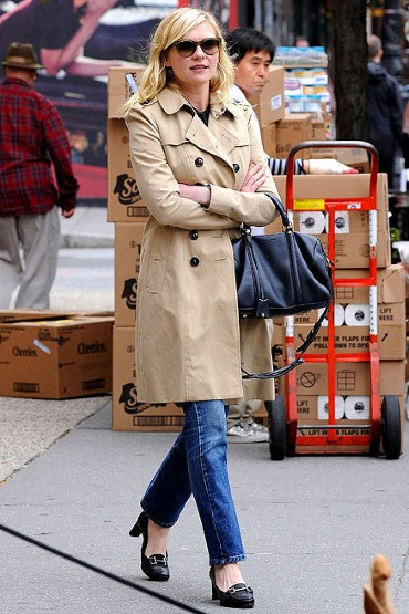 Kirsten Dunst in Trench coat and loafers