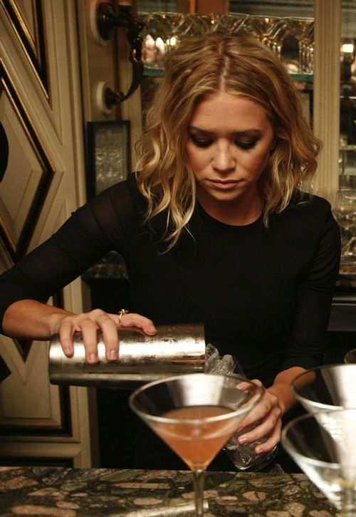 Ashley Olsen mixing cocktails