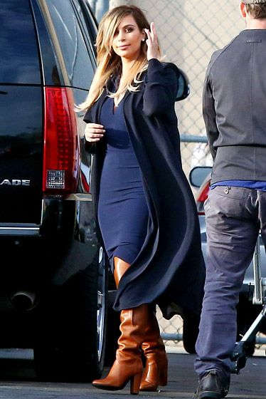 Kim Kardashian in navy dress and brown boots