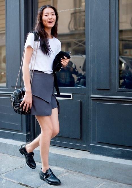 Model Liu Wen in grey wrap skirt and white tee