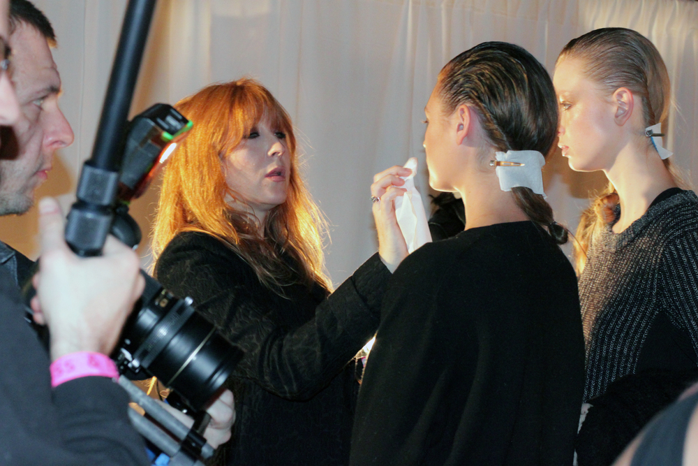 Charlotte Tilbry fixing up a model