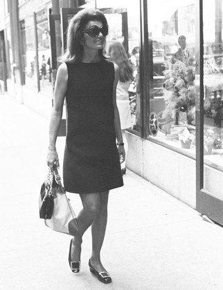 Jackie O in black shift dress
