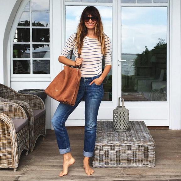 Caroline de Maigret Carolina Herrera bag + striped tee on holiday in the south of France