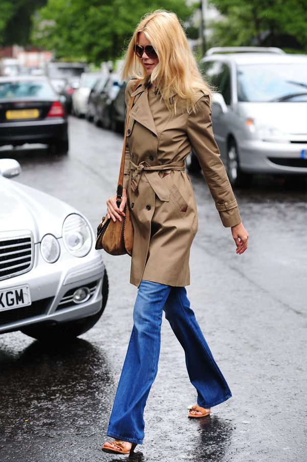 Claudia Schiffer in a trench and flared jeans
