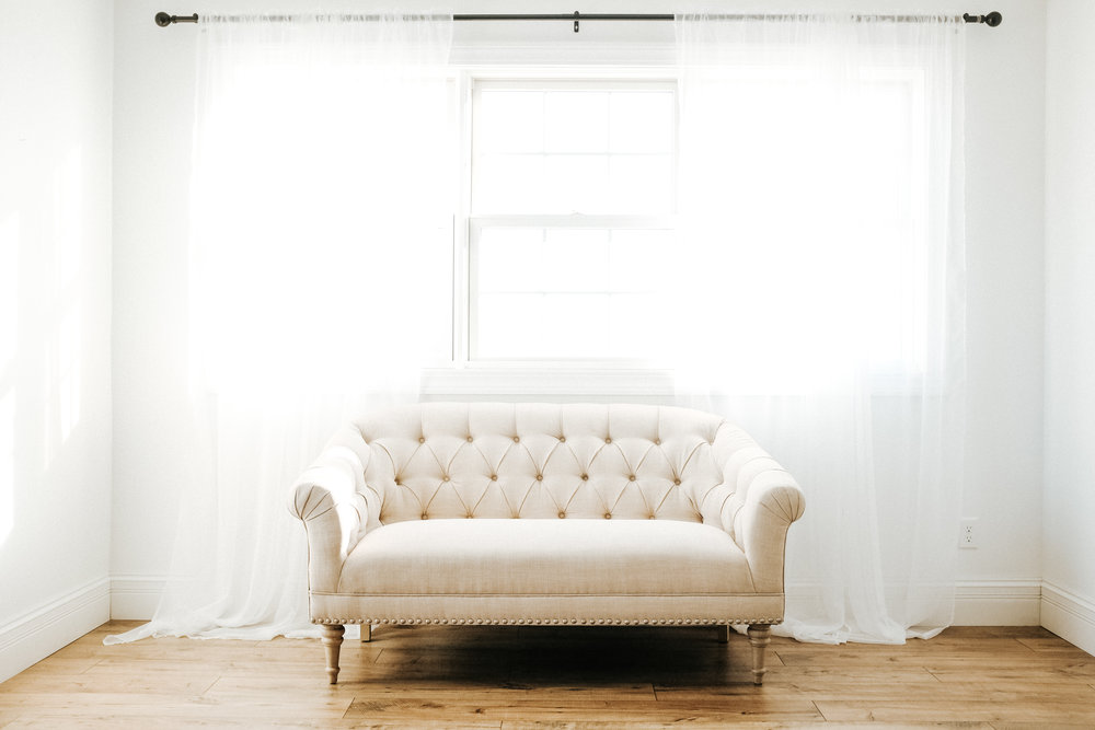 Tufted linen couch, lightweight enough for one person to push around and move on their own!