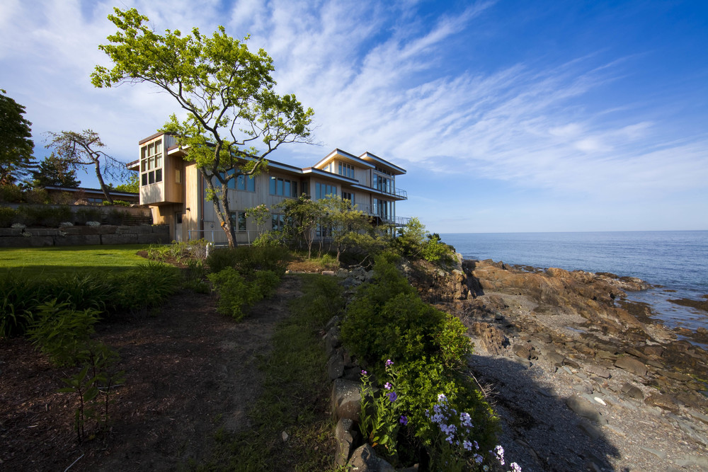 Renovation and expansion of a classic, mid-century modern home overlooking the rocky shoreline to make room for a large family.