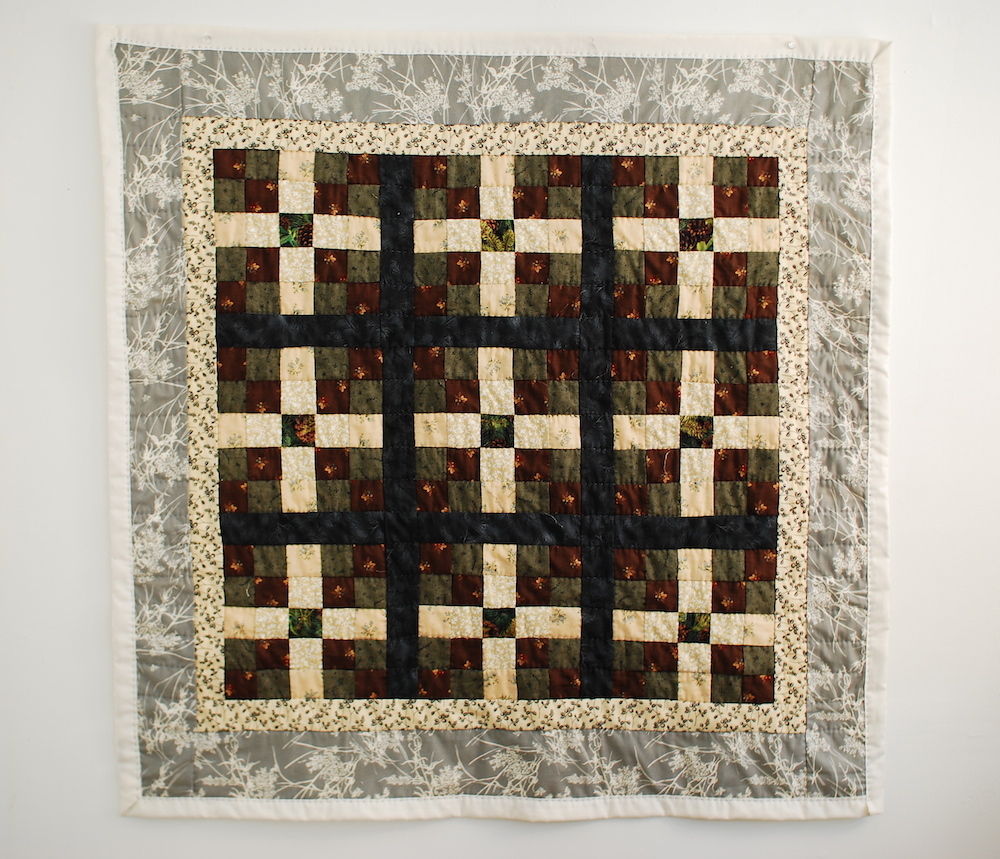 Raccoon Kit Quilt,  (before animal contact), hand stitched quilting cotton, 2010