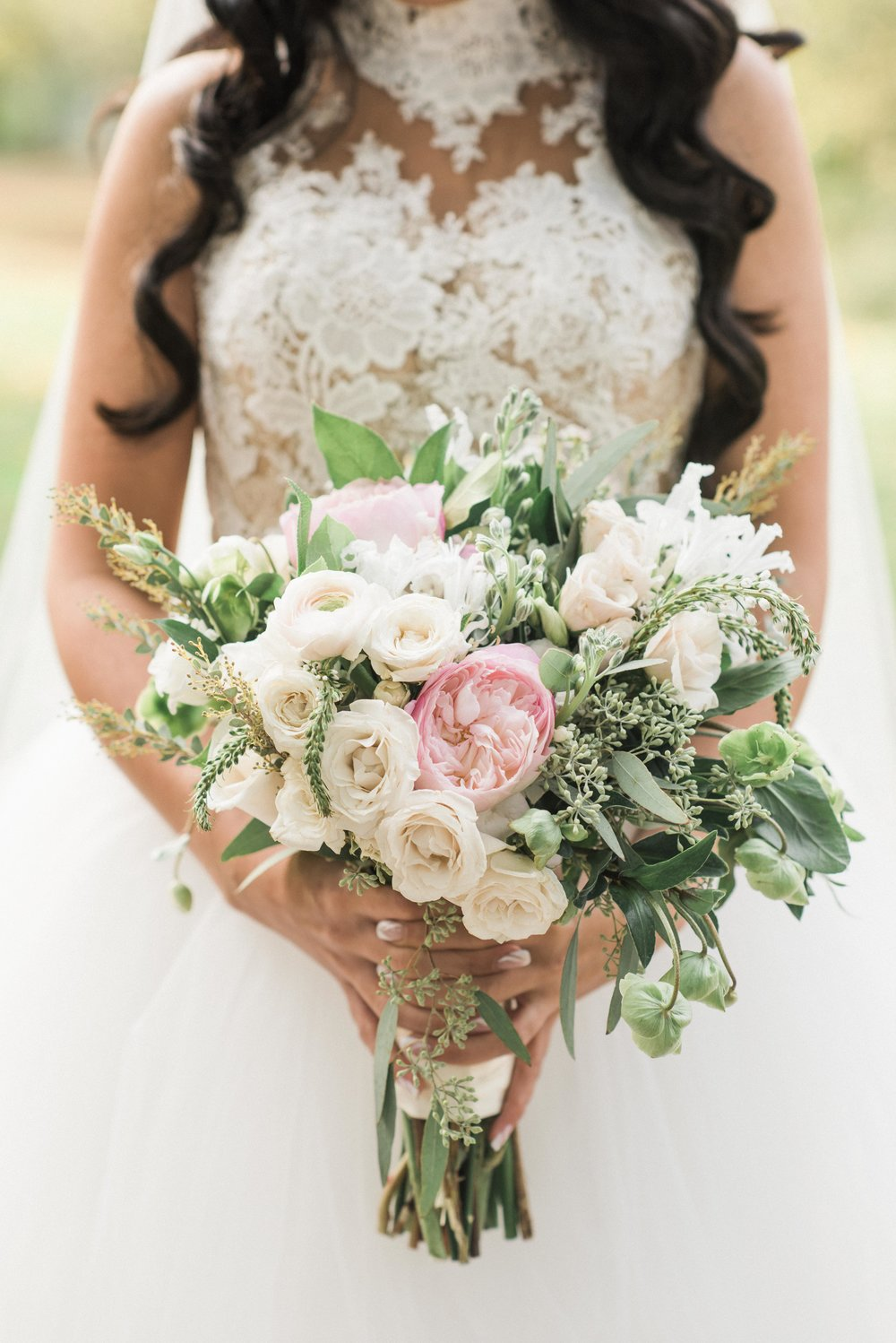 Bride, Bridal Bouquet, Bouquet shot, beautiful wedding flowers, wedding flowers, bride holding her bouquet, princess wedding gown, wedding gown with lace