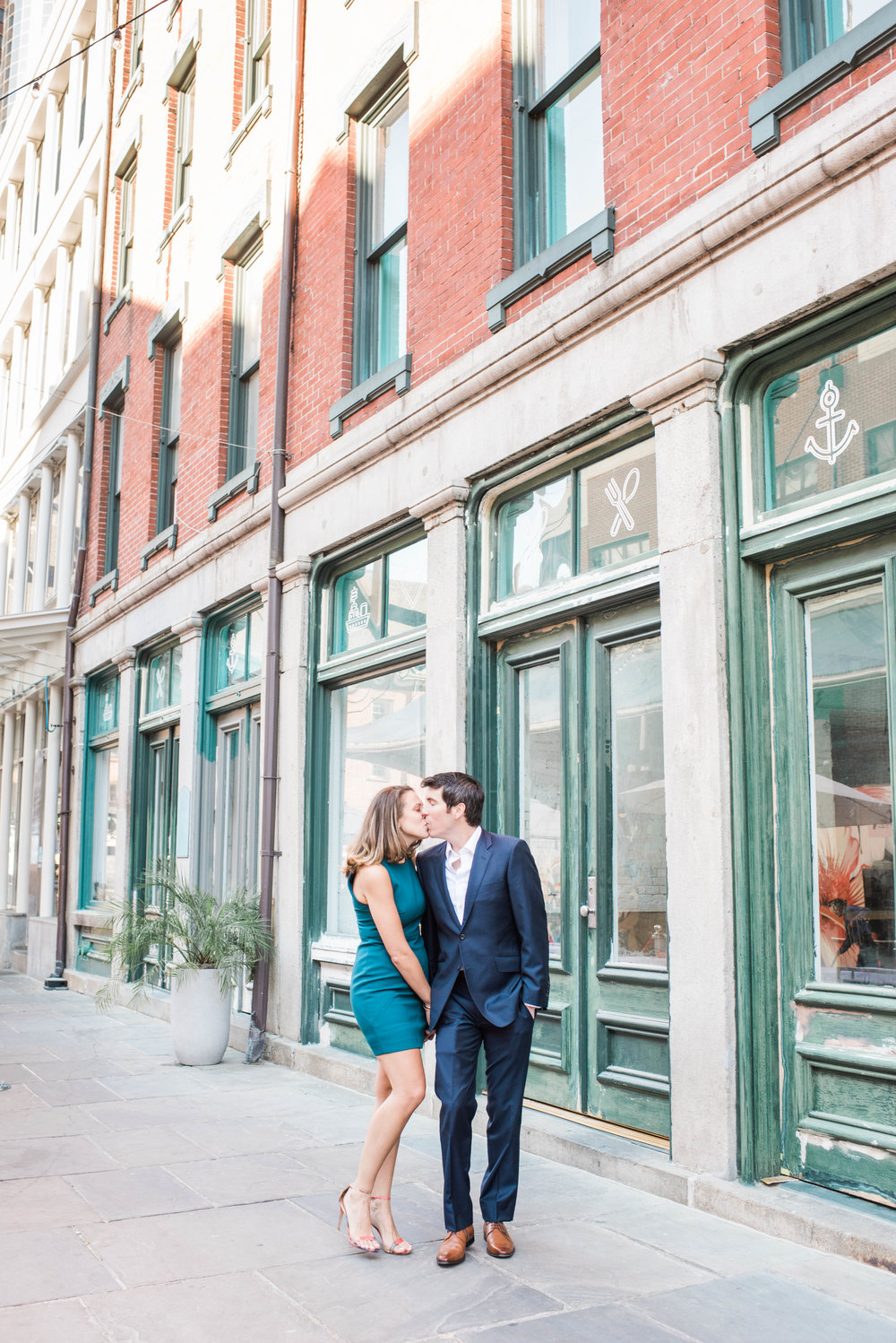 Walking in South street seaport, south street seaport, south street seaport engagement, Saturday morning, photographer's dream, engaged couple, pastel color, fiancee, kisses, kissing in the street