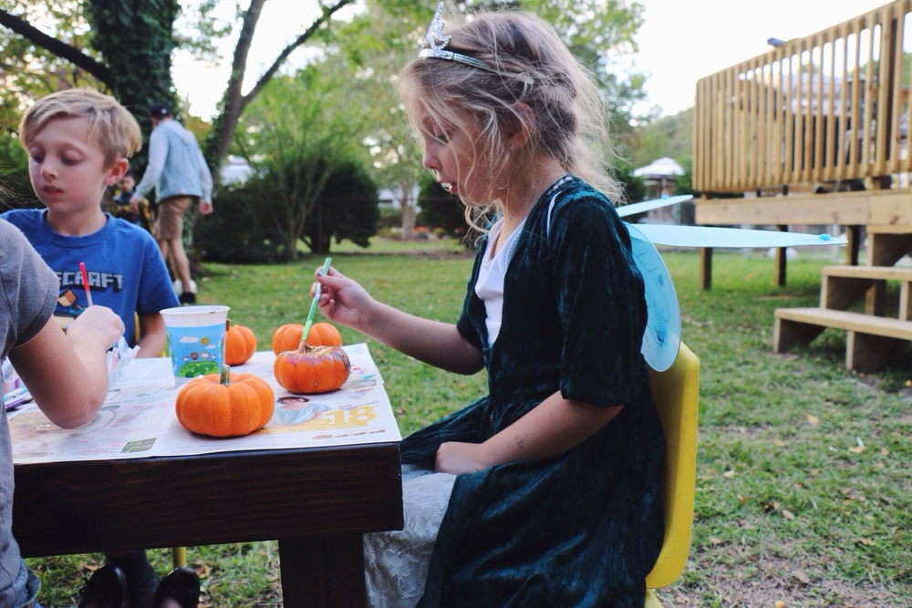 Princess Brooklyn concentrating on her pumpkin art.