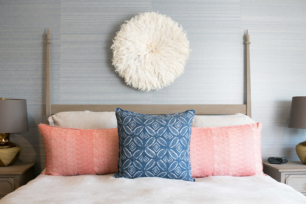 The St. Frank African Juju hat above the bed adds texture and personality to this space.