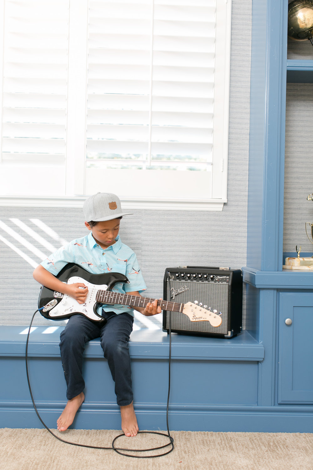 When he is not riding dirt bikes, skating or surfing, this kid is trying his hand at jamming on the guitar.