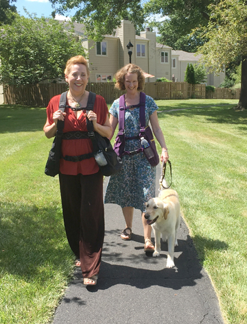 Peggy, Mel and Jingles out walking with the BackTpack