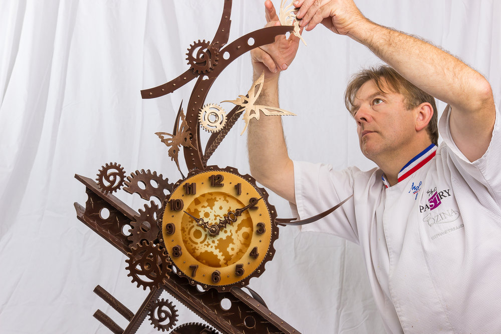 Chef Stéphane Tréand creating an artistic chocolate showpiece in front of a private viewing!
