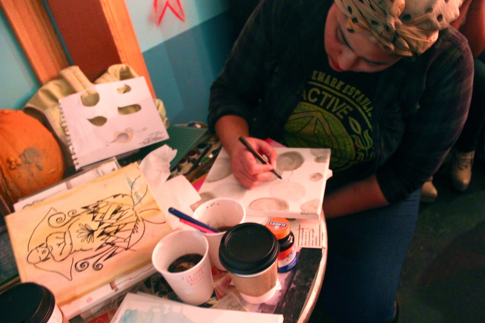 Puka, visual artist creating live watercolor canvases of women317 performances.