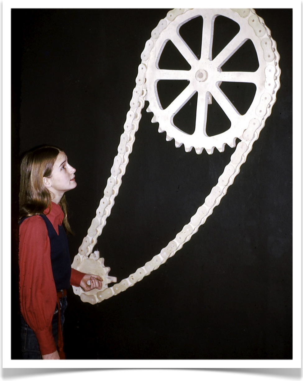 Marji, in 1973 with her bicycle chain sculpture.