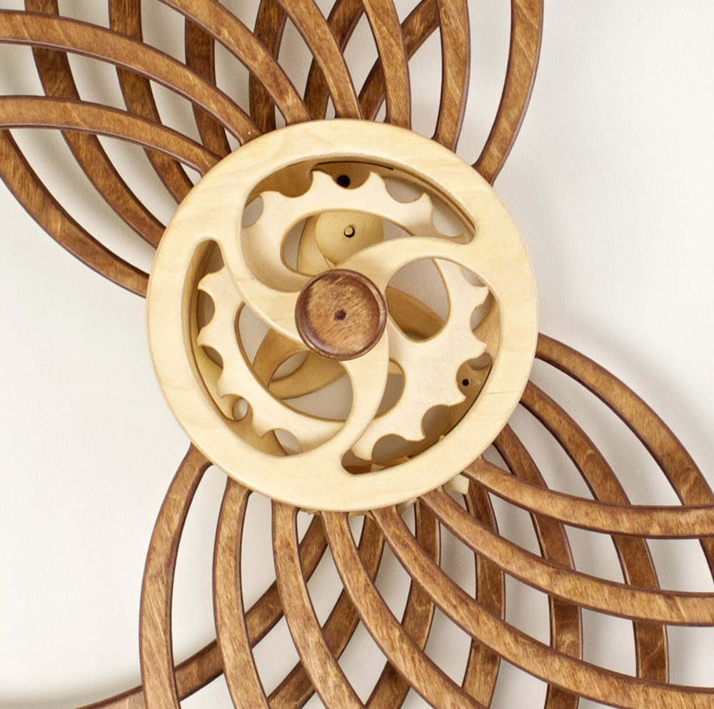 Detail of Infinity kinetic sculpture by David C. Roy. Spring-driven wooden kinetic art that moves