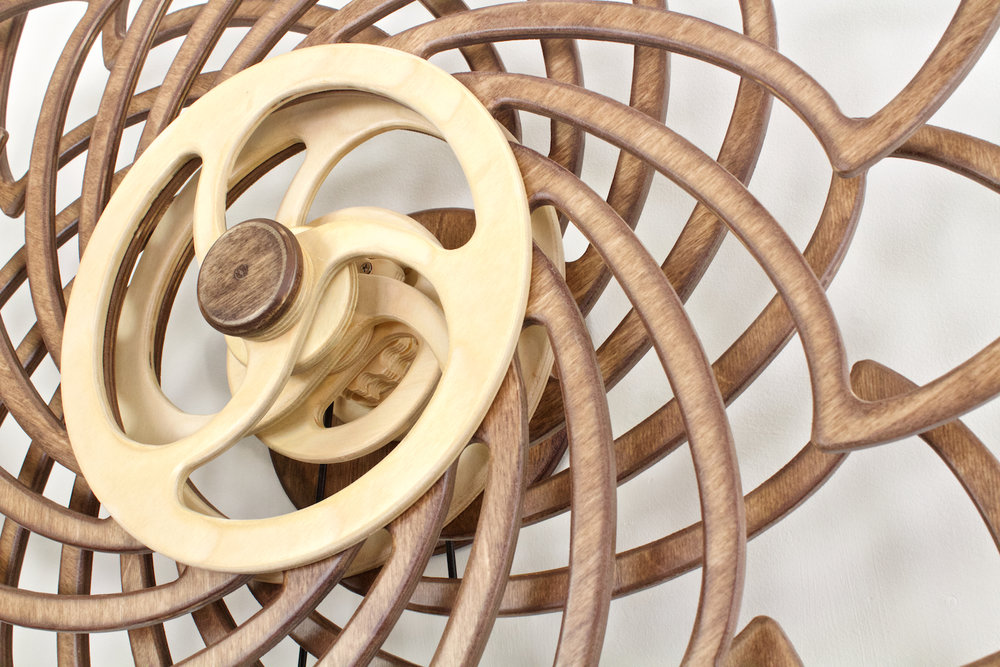 Deja Vu detail view. Kinetic wall sculpture by David C. Roy of Wood That Works