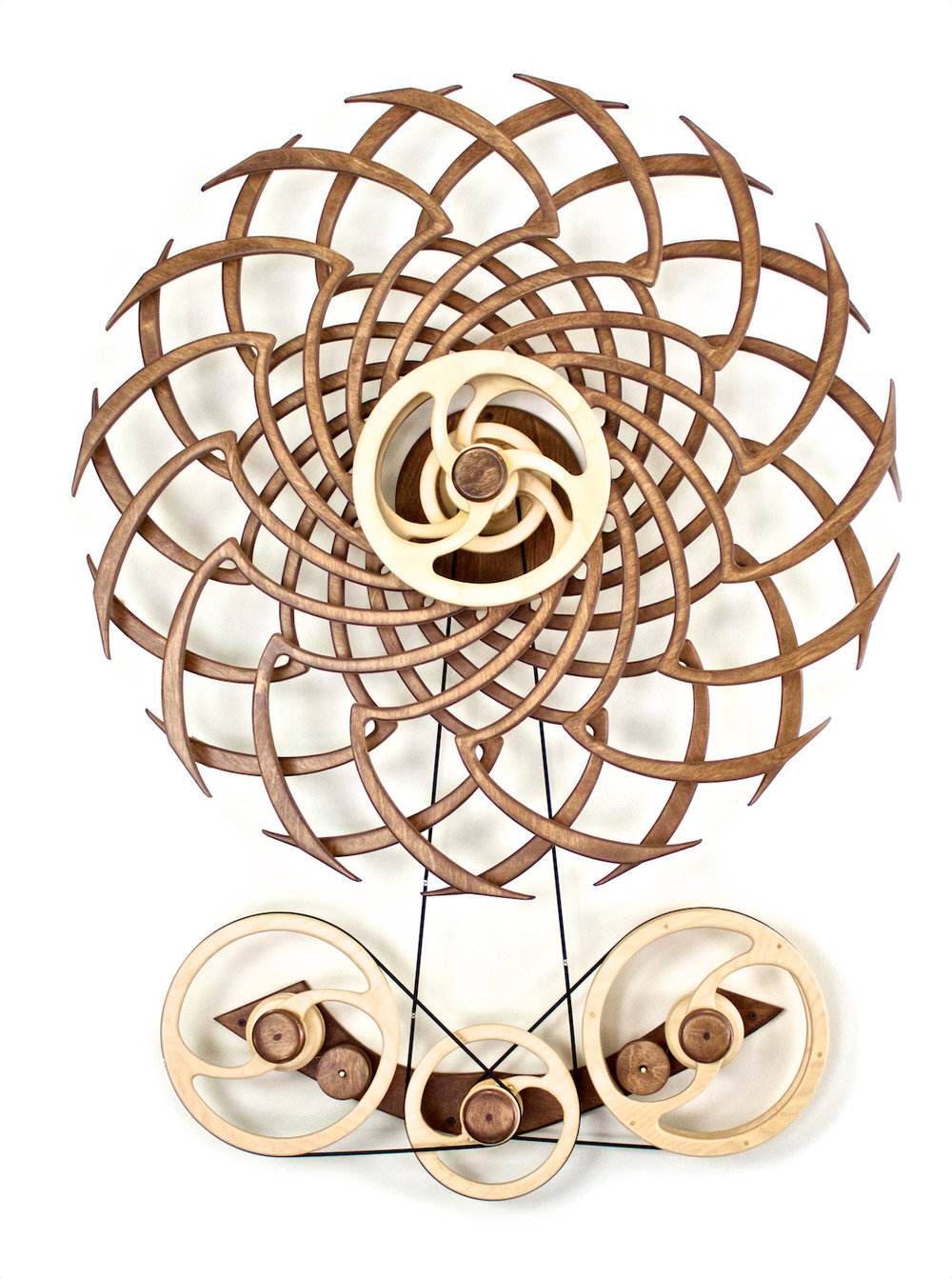 Deja Vu - Spring-driven kinetic wall sculpture by David C. Roy of Wood That Works.