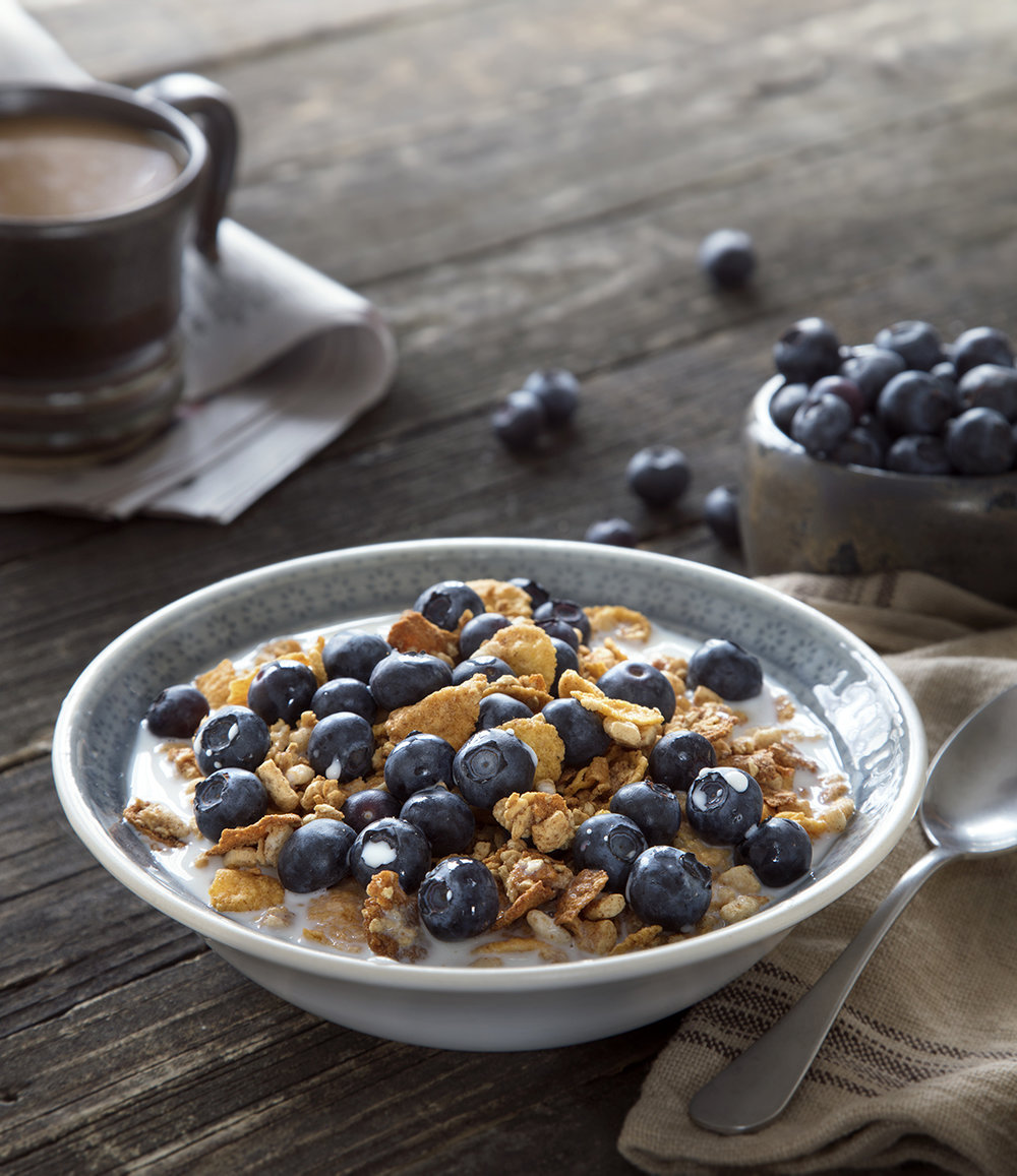 food photography of cereal and blueberries