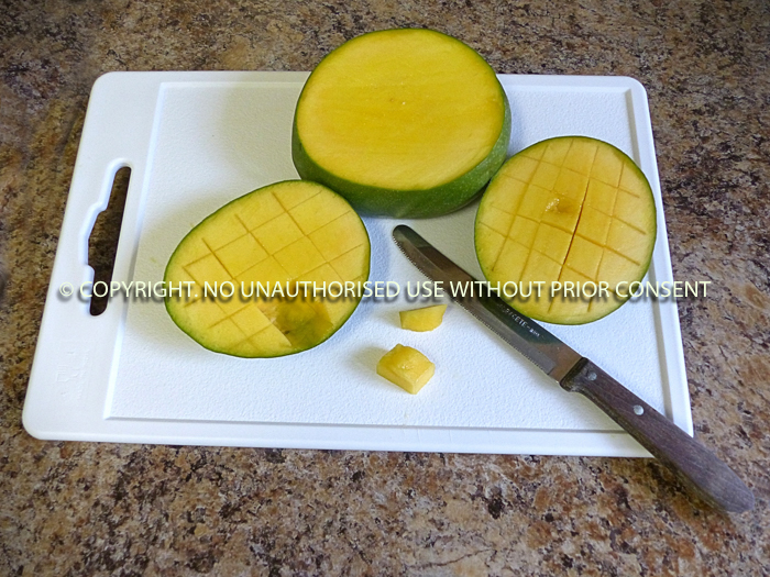 PREPARING MANGO by Irene Clarke.jpg