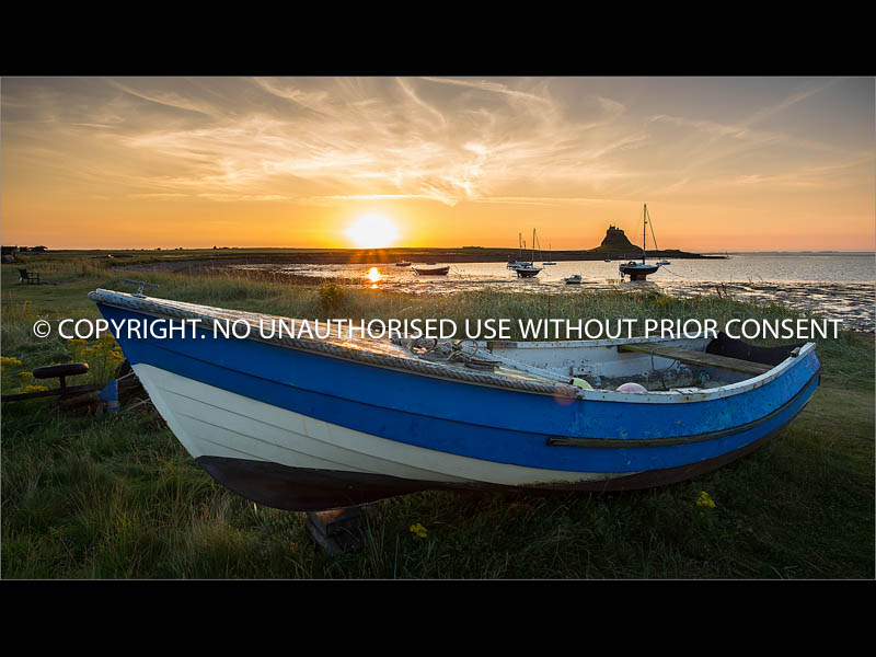 SUNRISE AT LINDISFARNE by Jamie White.jpg