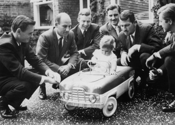Left to right: Bruce McLaren, Stirling Moss, Tony Brooks, baby Damon Hill, Graham Hill, Jo Bonnier, Wolfgang von Trips photo: Keystone, Getty Images
