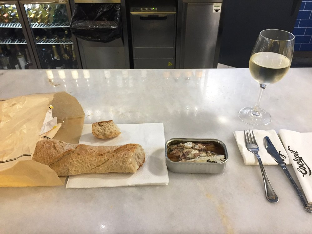 portuguese bread, wine, and sardines in the silkiest, stupidest olive oil that an airport merchant gave me for free