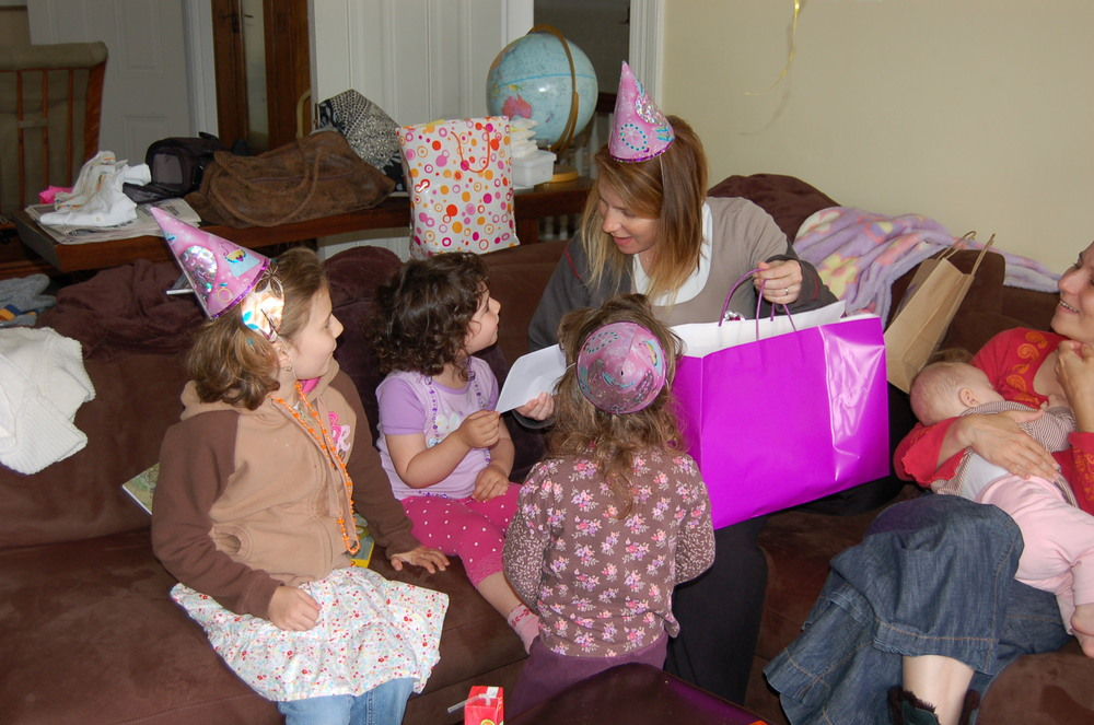 Our big sister party the day we came home from the hospital.    That's my lil' sis on the right nursing my niece with her two older girls looking at me and the guest of honor.     Here's another one from the day on  Instagram