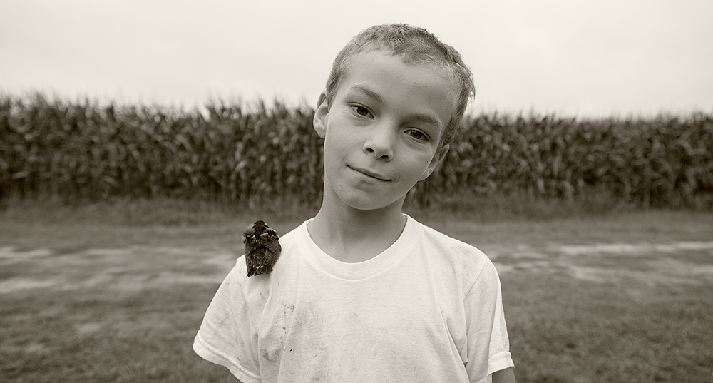 The boy and his bird, near Accomack, Virginia