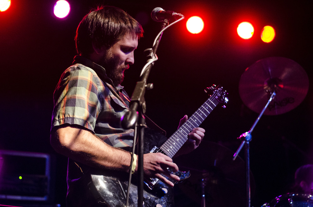 Beyond I Sight guitarist Jeremy Santizo leans back during a solo