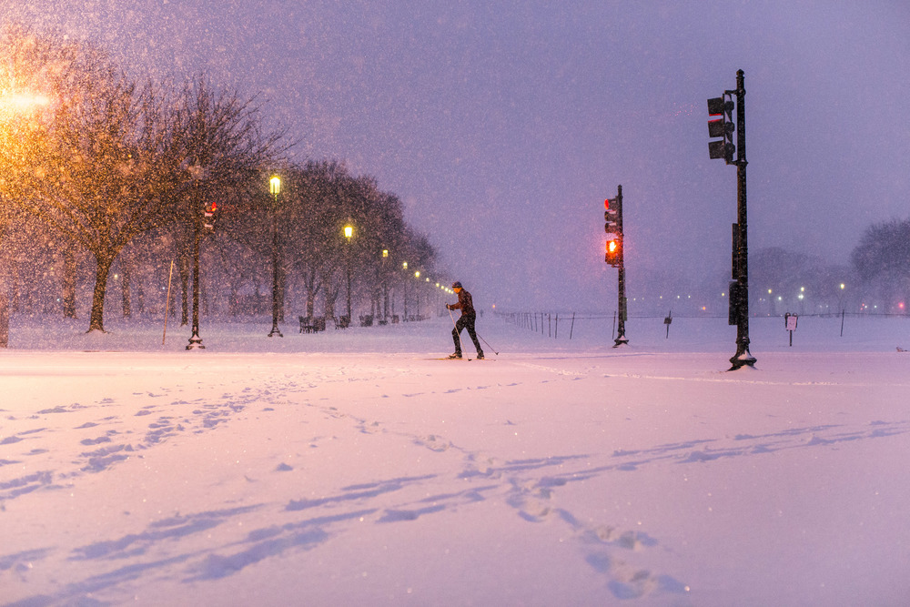 Cross-country skiing across the National Mall. Somewhere in the background, the Washington Memorial is veiled by the snowfall.