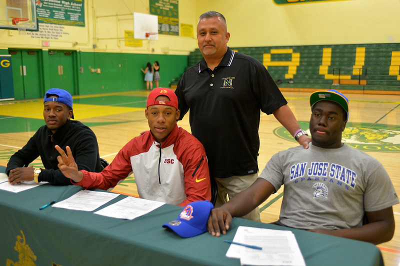 Khalil Rashad-Brown (San Jose State), Uchenna Nwosu (USC), and Owen Roberts (San Jose State) celebrate signing day with Head Coach Manuel Douglas.