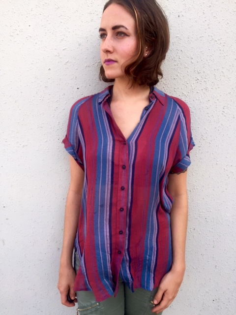 This blouse reminds me of a Fading Old Glory. It can be found here at Urban Outfitters.
