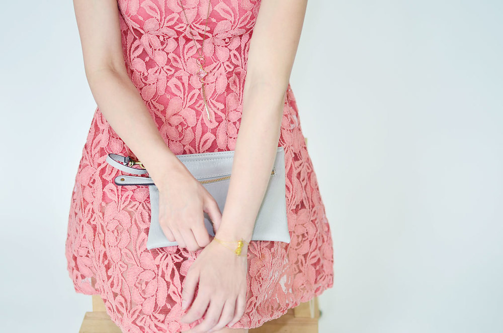 Front shot of FP salmon pink lace dress with UO clutch and Gorjana heart bracelet.