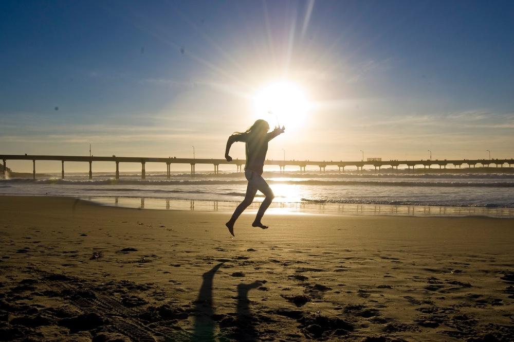 Jenny Jumping On Beach.jpg